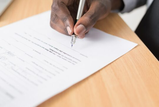 man signing an insurance contract